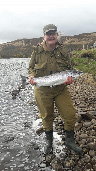Helen proudly displays her salmon