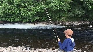 Young lad fishing the Naver